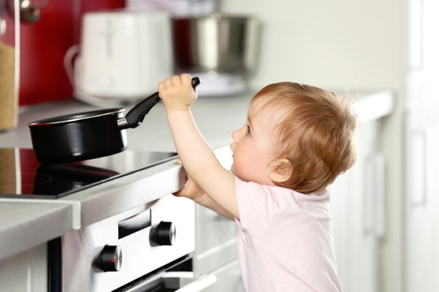 Small Child Playing With a Pan