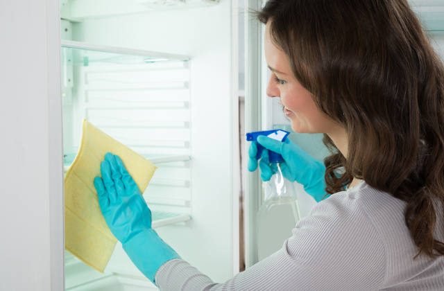 Woman cleaning out the fridge