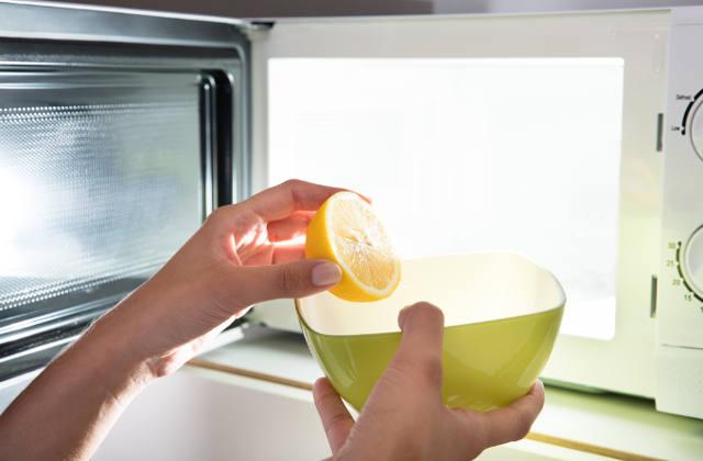 Woman putting lemon in a bowl
